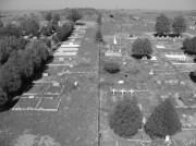 An overhead view of the Marfa cemetery. Located on the northwestern edge of town (pictured on the right-hand side of the image), the headstones, cement markers and painted wooden crosses in the dirt to the north of the fence primarily commemorate the dead