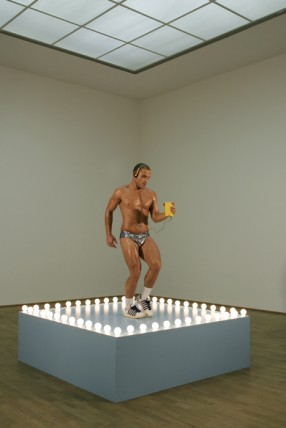 Sturtevant, Gonzalez-Torres Untitled (Go-GO Dancing Platform), 1995, wood, light-bulbs, acrylic paint, wire and go-go dancer in silver lame bikini and Walkman, 54.5x183x183cm. Courtesy of the artist.